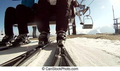 skiing resort - chair lift and skiers, spectacular pov