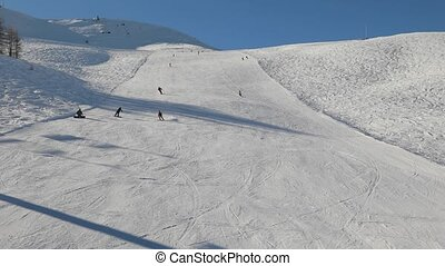 Skiing slopes with skiers - Skiing slope with many skiers,...