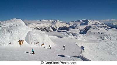 Group of people skiing down off of Whistler Peak