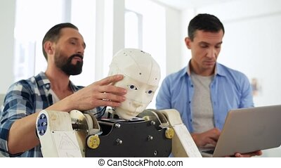 Skilled engineers working with robot construction - Powerful...