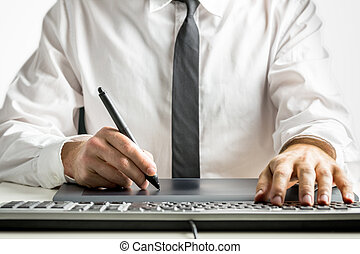 Skilled male designer drawing on a graphics tablet