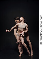 Skilled young ballet dancers performing together in the studio