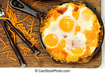 Skillet Baked Eggs and Sausage with Cheese on Table