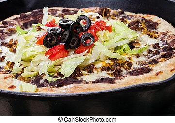Skillet pizza with olives