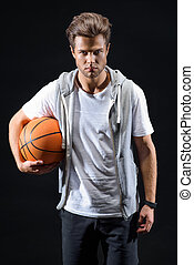 Skillful basketball player posing with confidence