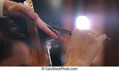 Skillful hairdresser cutting male hair. - Skillful...