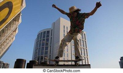 Skillful man skater skateboarding outdoors - Side view of...