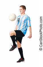 Skillful player - Soccer player control a ball with his...