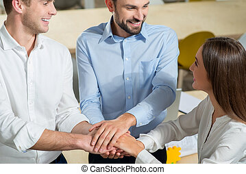 Skillful young colleagues are working together with joy