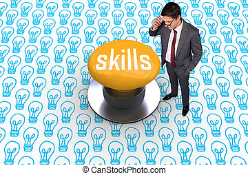 Skills against yellow push button - The word skills and ...