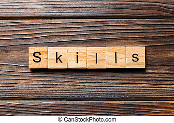 Skills word written on wood block. Skills text on wooden table for your desing, concept