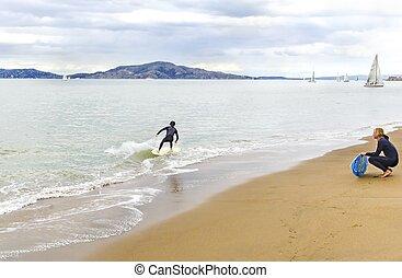 Skimboarding in San Francisco Bay, California
