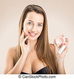 Skin Care - Beautiful woman with face cream