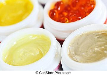 Skin care creams - Colorful jars of skin care creams and...