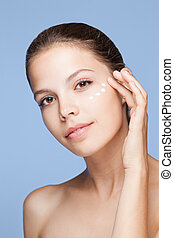 Skin care. - Portrait of a beautiful young brunette woman ...