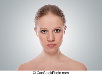 skin care. portrait of a beautiful young woman frontal on a gray background