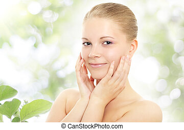 Skin care - Portrait of the attractive girl on nature...