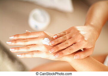 skin care - Young women applaying cream on her skin