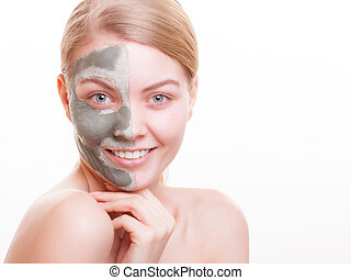 Skin care. Woman applying clay mask on face. Spa. - Skin...