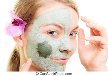 Skin care. Woman in clay mud mask on face. Beauty. - Skin...