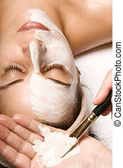 Skin care - woman relaxing with a nice facial massage