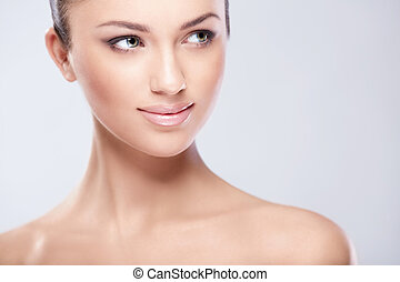 Skin care - Young attractive girl in studio