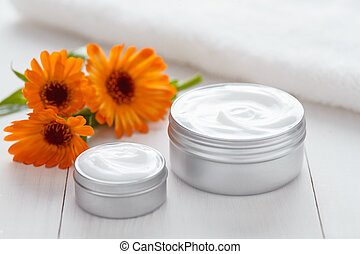 Skin cleansing cosmetic cream with calendula flowers vitamin spa lotion