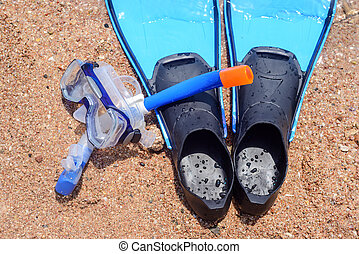 Skin diving gear lying ready on the beach