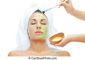 skin treatment - portrait of young beautiful woman being...