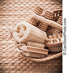 Skincare collection of objects in basket on wicker texture sauna