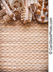 Skincare collection of objects on wicker texture copy space imag