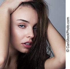 Skincare concept - beautiful woman face closeup