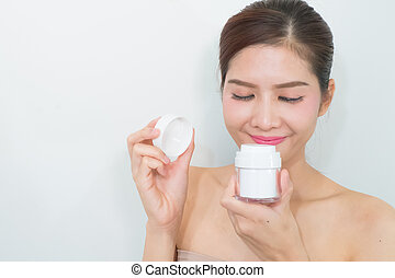 skincare products, Portrait of Beautiful Young Woman looking at Camera. Beautiful Asian female model on white background