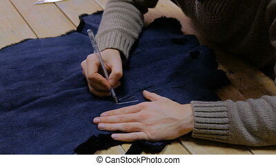 Skinner working with beaver fur skin - Professional male...