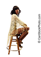Skinny African American Woman Sitting Gold Shawl