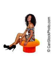 Skinny African American Woman Sitting Orange Stool