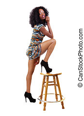 Skinny African American Woman Standing With Wooden Stool