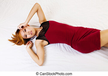 Skinny Asian American Reclining On Floor Red Dress