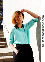 Skinny Asian American Woman Outdoors Pants And Shirt