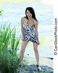 Skinny Asian American Woman Outdoors Short Dress