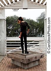 Skinny Asian American Woman Standing Black Pants