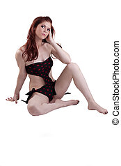Skinny Attractive Redhead Woman Swim Suit Sitting