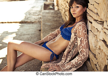 Skinny brunette lady relaxing in tropics