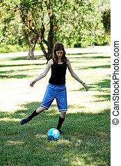 Skinny Caucasian Teen Girl Kicking Blue Soccer Ball