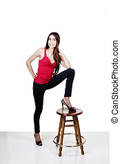 Skinny Hispanic Woman Smiling Foot On Stool