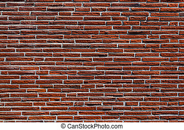 Skinny red brick wall