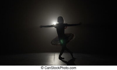 Skinny silhouette of a ballerina doing a graceful reverence in slow motion