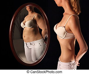 Skinny woman seeing herself fat in a mirrow