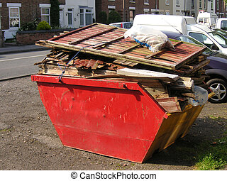 skip of rubbish - small skip filled with rubbish from the...