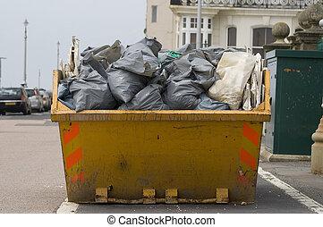 skip with refuse/trash sacks - a skip full of refuse/trash...